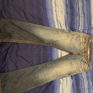 Worn True religion straight leg jeans .